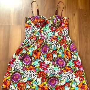 A cup fitted bodice w/ adjustable straps sundress